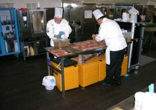 Photo3, De Jerry an den Jean-Claudebei der Preparatioun vum Menu